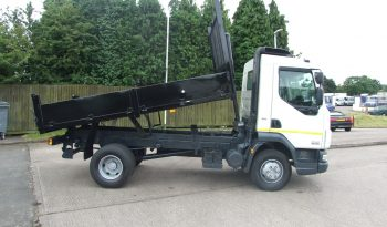 side view of white ex council tipper truck