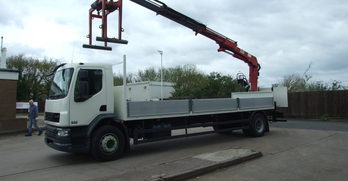Passenger side view of used DAF crane truck